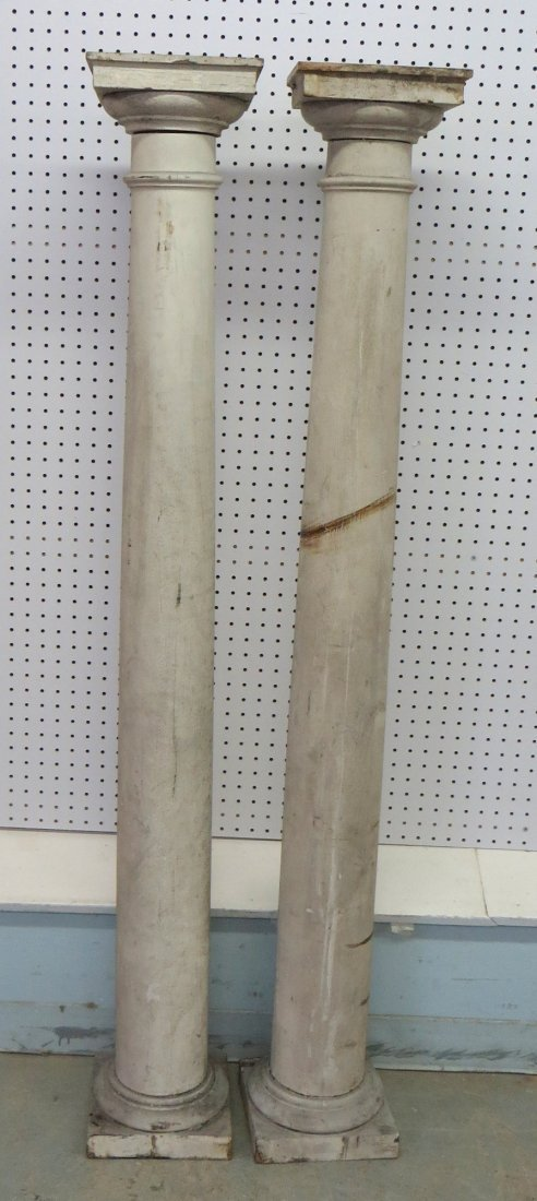Two 19th century wooden columns, one with losses on sid