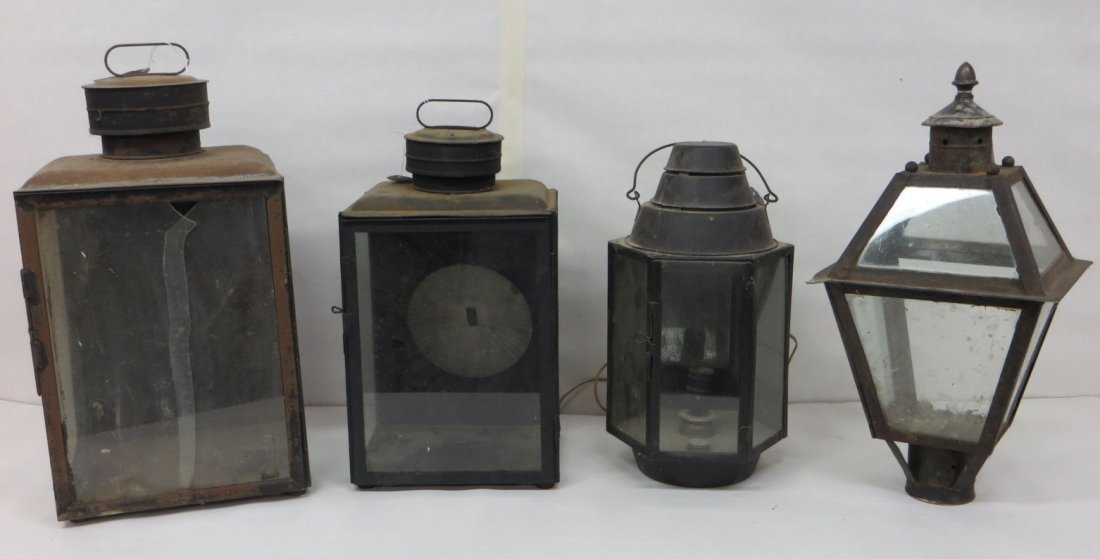 Four early tin lighting devices - most with repairs and