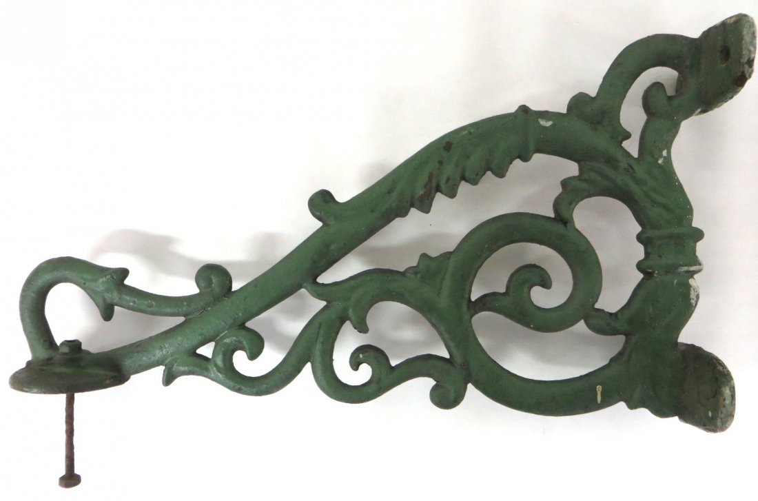 Large painted cast iron wall bracket, probably for hold