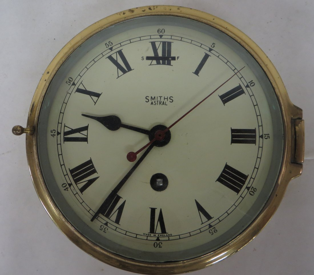 "English brass ship's clock signed Smith's Astral. 7""D."