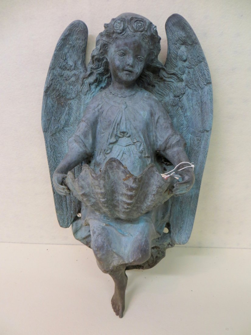 Small wall mounted zinc garden ornament in the form of