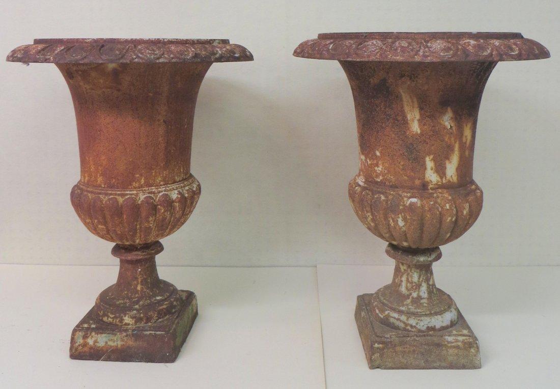 """Two cast iron garden urns - 25""""H x 18""""D."""
