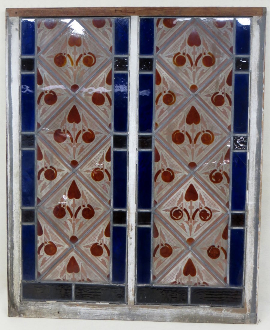 Beautiful stained and leaded glass window in orange, pu