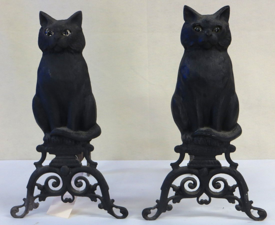 Cast iron seated cat andirons with glass eyes
