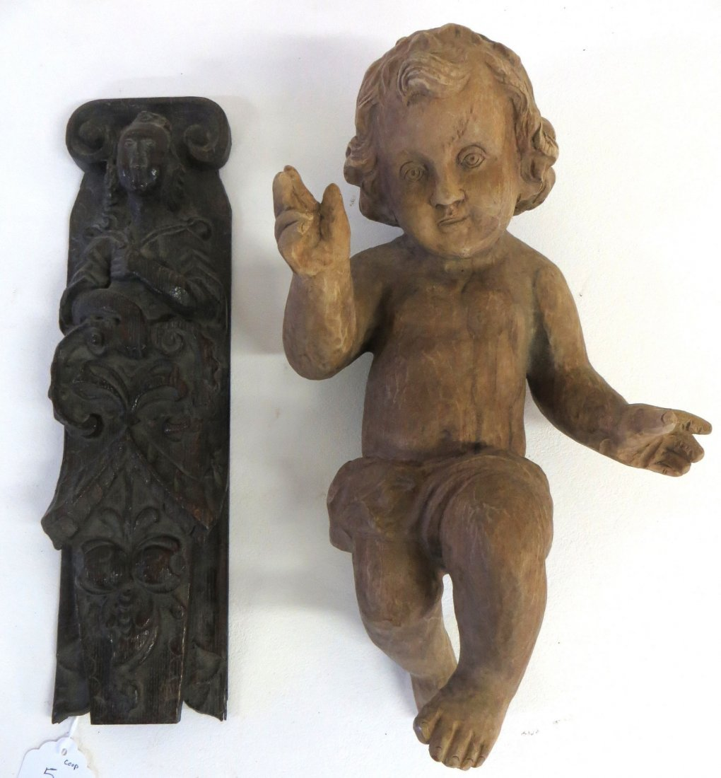 Two carved wooden ornaments including a figure of Baby