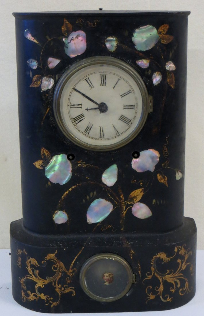 Cast iron Victorian mantle clock with mother-of-pearl
