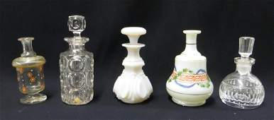 Five early dresser bottles, most hand blown including