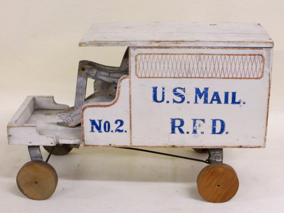 Old wooden mechanical toy mail truck marked U.S. Mail