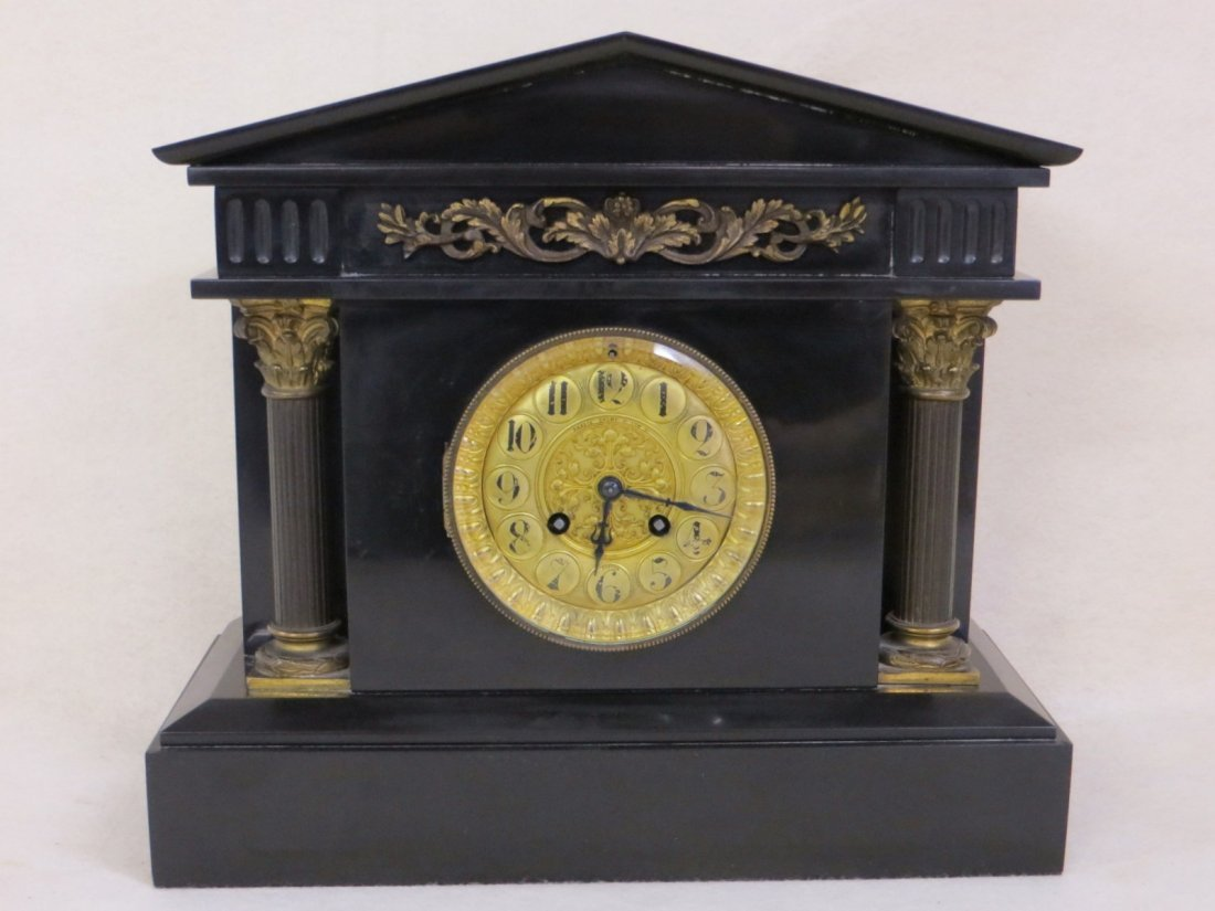 Classical black slate Empire mantle clock.
