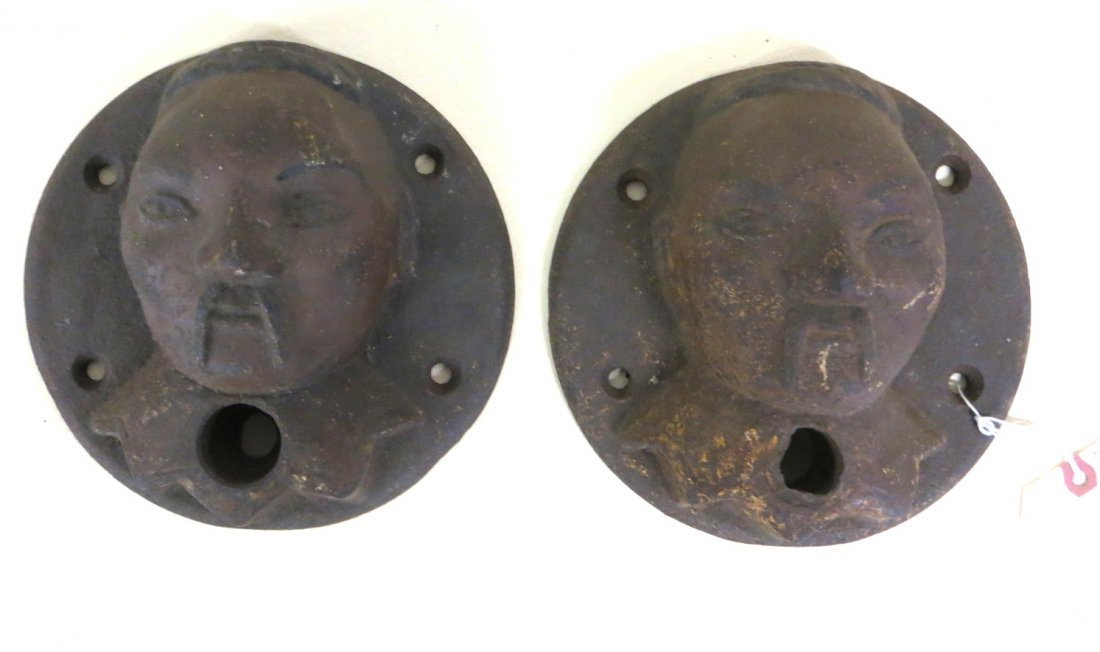 Pair of cast iron oriental figure heads, with traces of