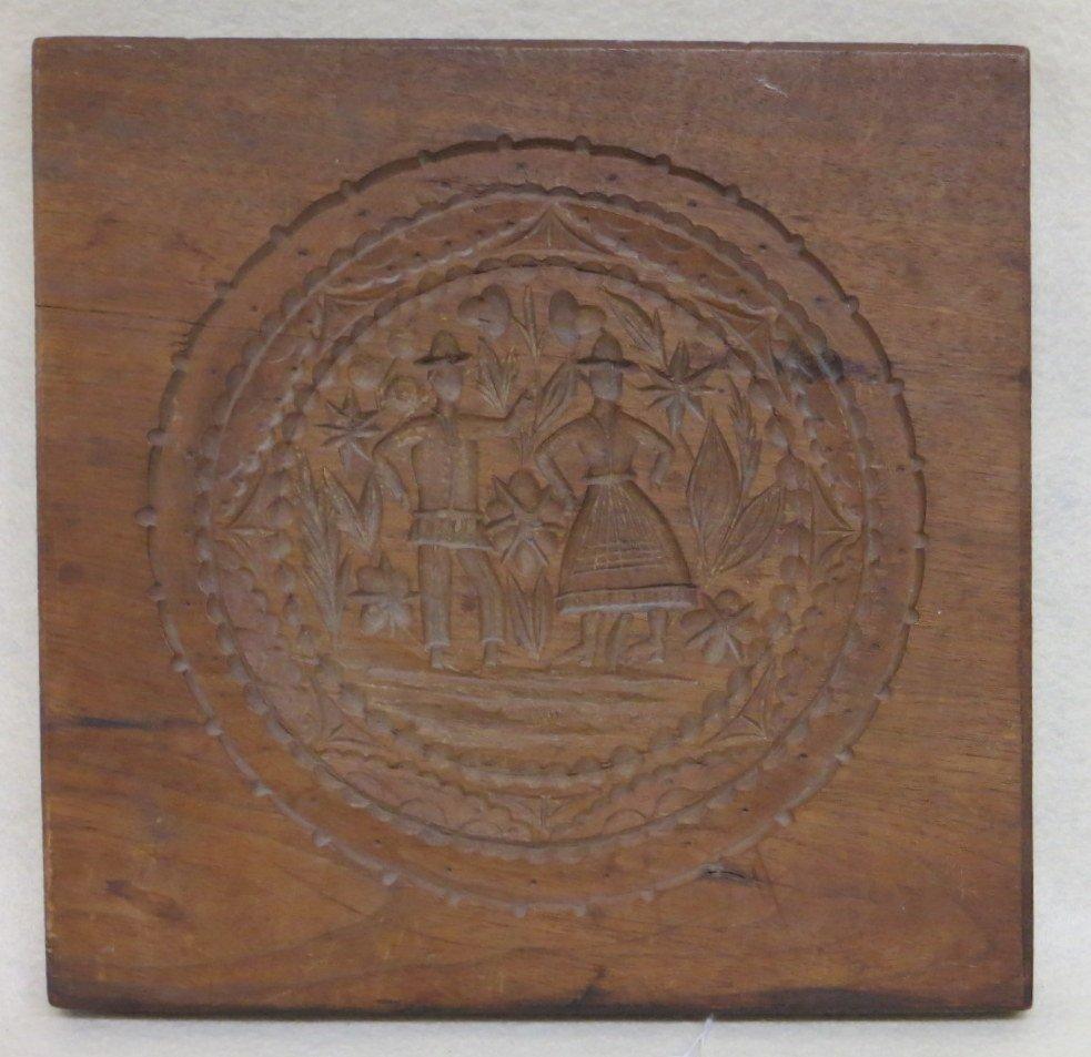 American mahogany cake board depicting a standing man
