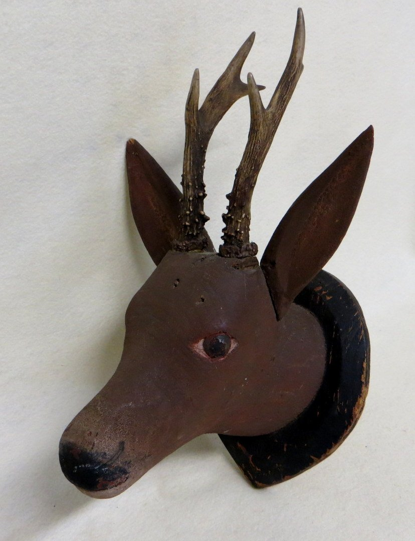 Hand carved wooden deer head with real antlers in