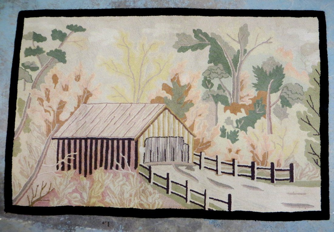 Hooked rug with scene of covered bridge and landscape -