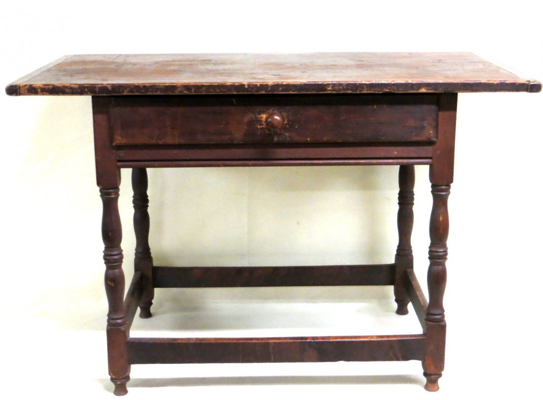 Tavern table with center drawer in original red stain,