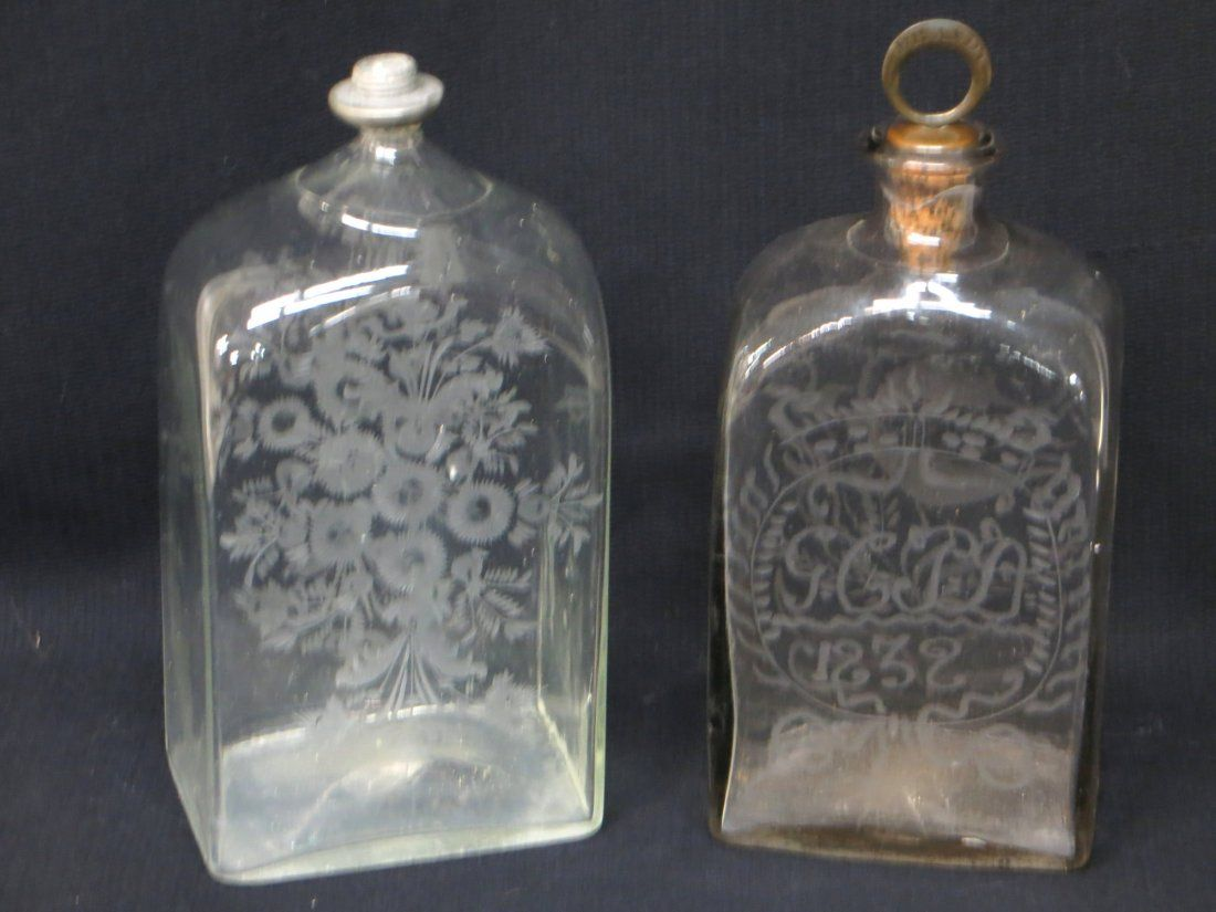 Two early hand blown etched bottles: Stiegel type with