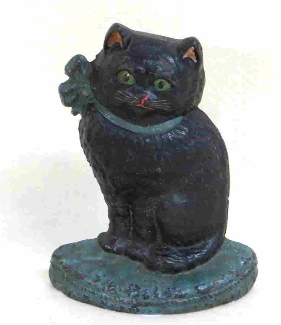 Hubley cast iron seated cat door stop wearing green bow