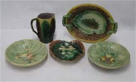 Five pieces of Victorian era majolica including milk