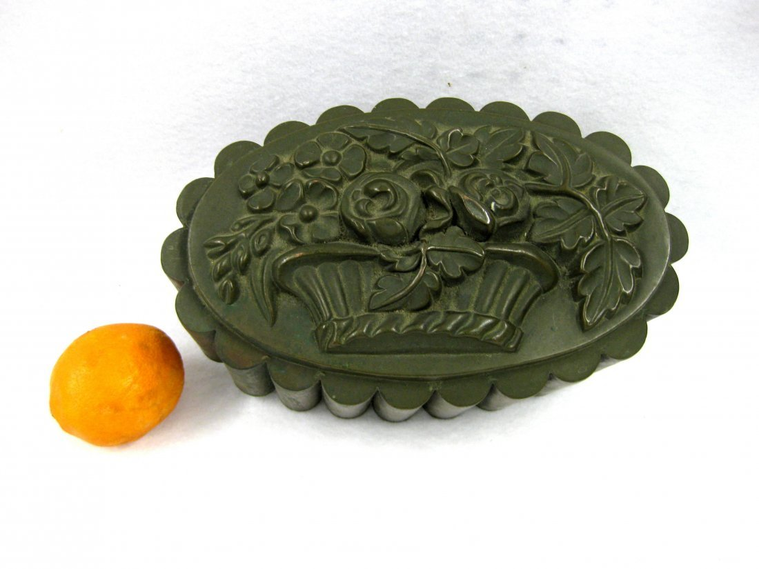 Large copper cake or Jello mold with basket of flower
