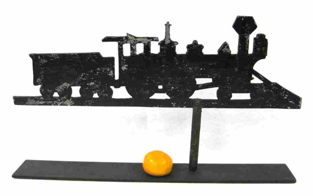 Old metal steam locomotive with tender silhouette