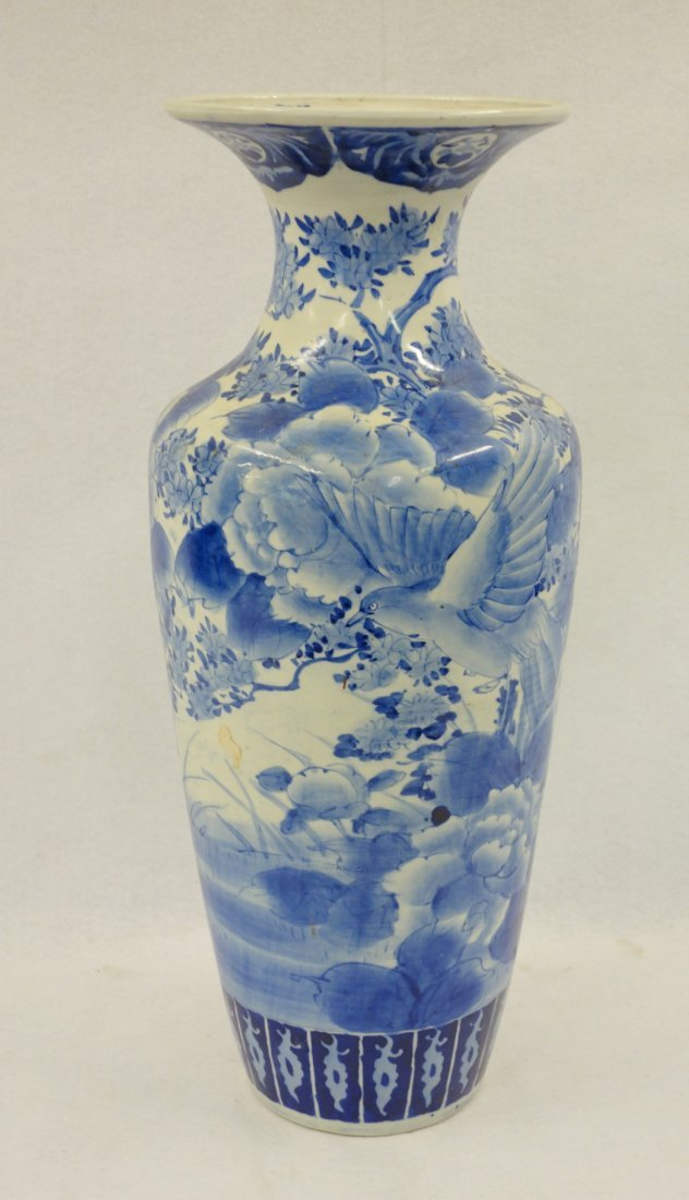 Large blue and white floor standing vase decorated with