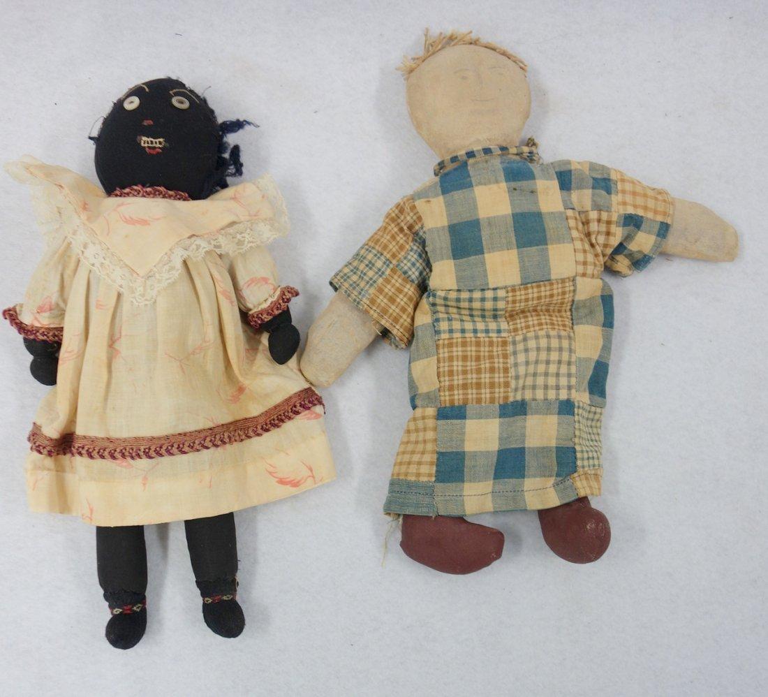 Two folk art cloth dolls, one Black golliwog doll (hair