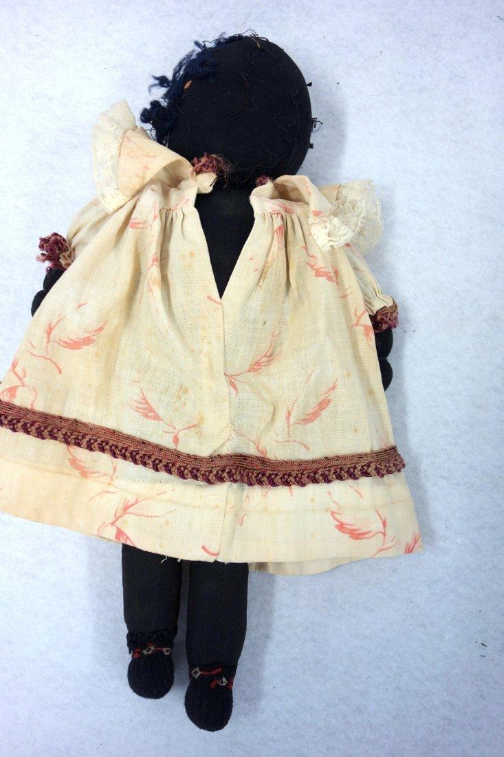 Two folk art cloth dolls, one Black golliwog doll (hair - 3