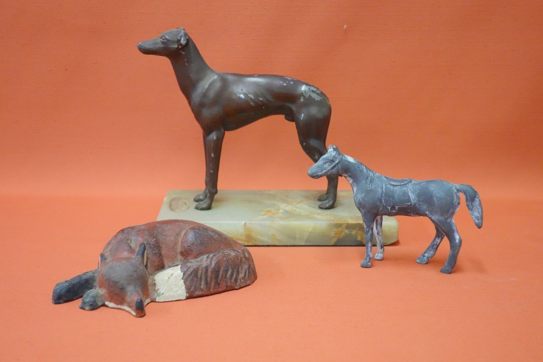 Three metal animal figures including: a whippet