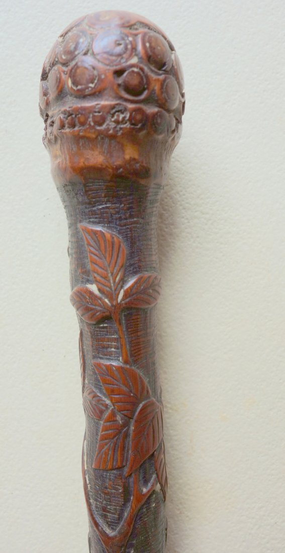 Root cane heavily carved on shaft with cranes, vines,