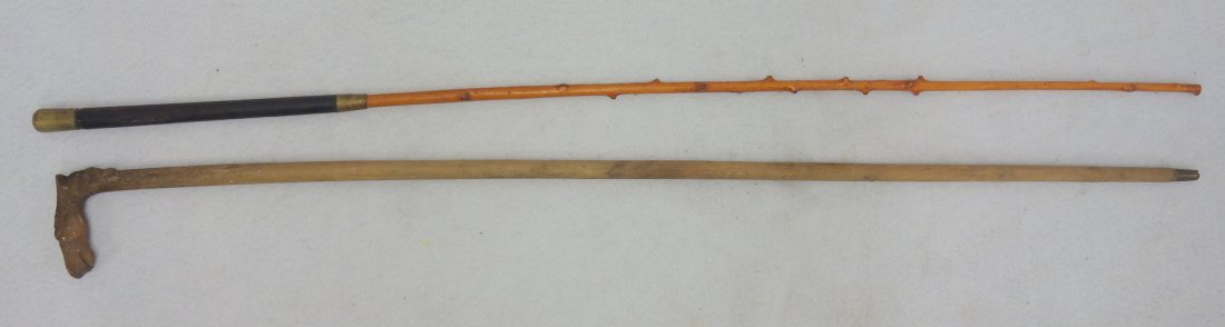 Two walking sticks, including one with carved horse