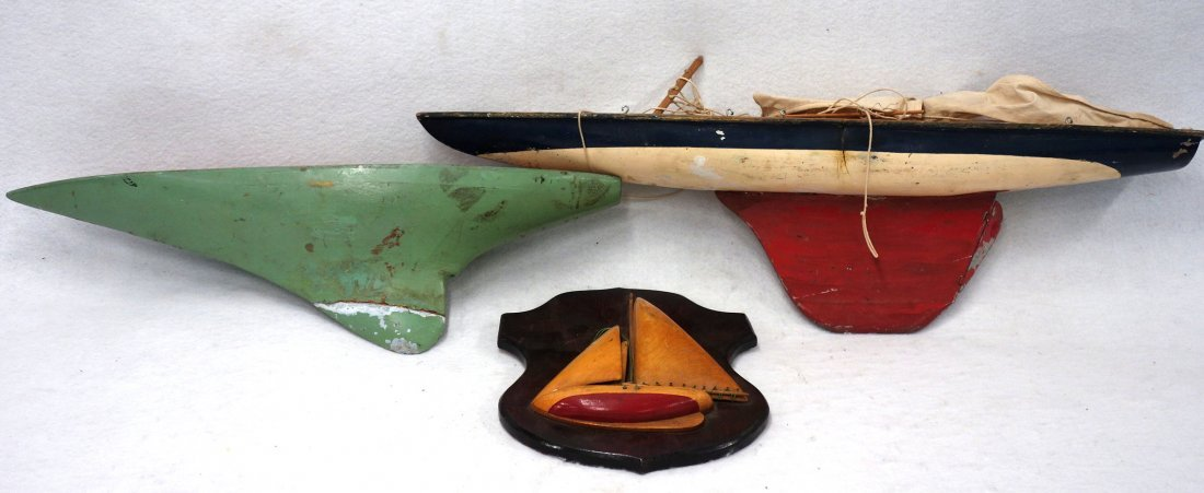 Three items including two pond boats: One with red,