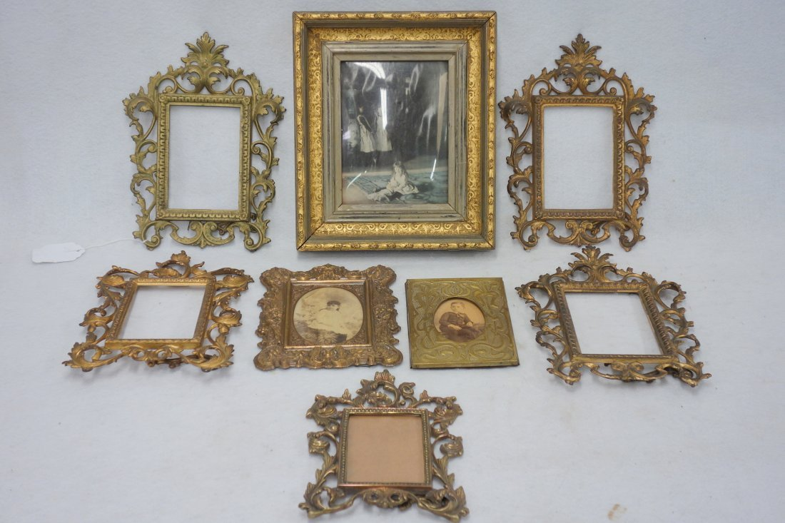 Grouping of eight picture frames including: A wooden