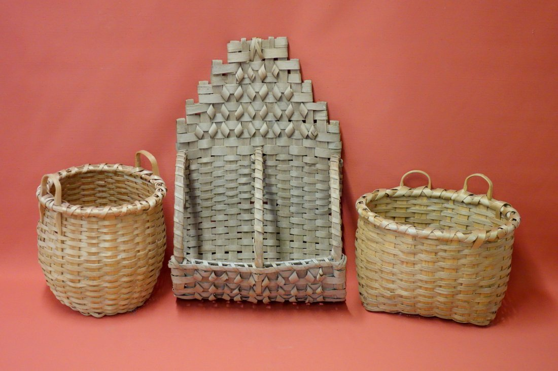 Three splint baskets including two wall hanging and one