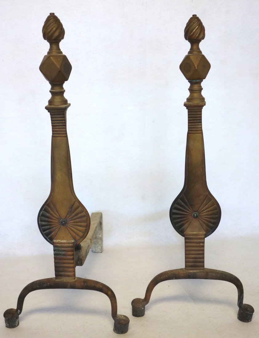 Pair of Queen Ann style brass andirons with penny feet
