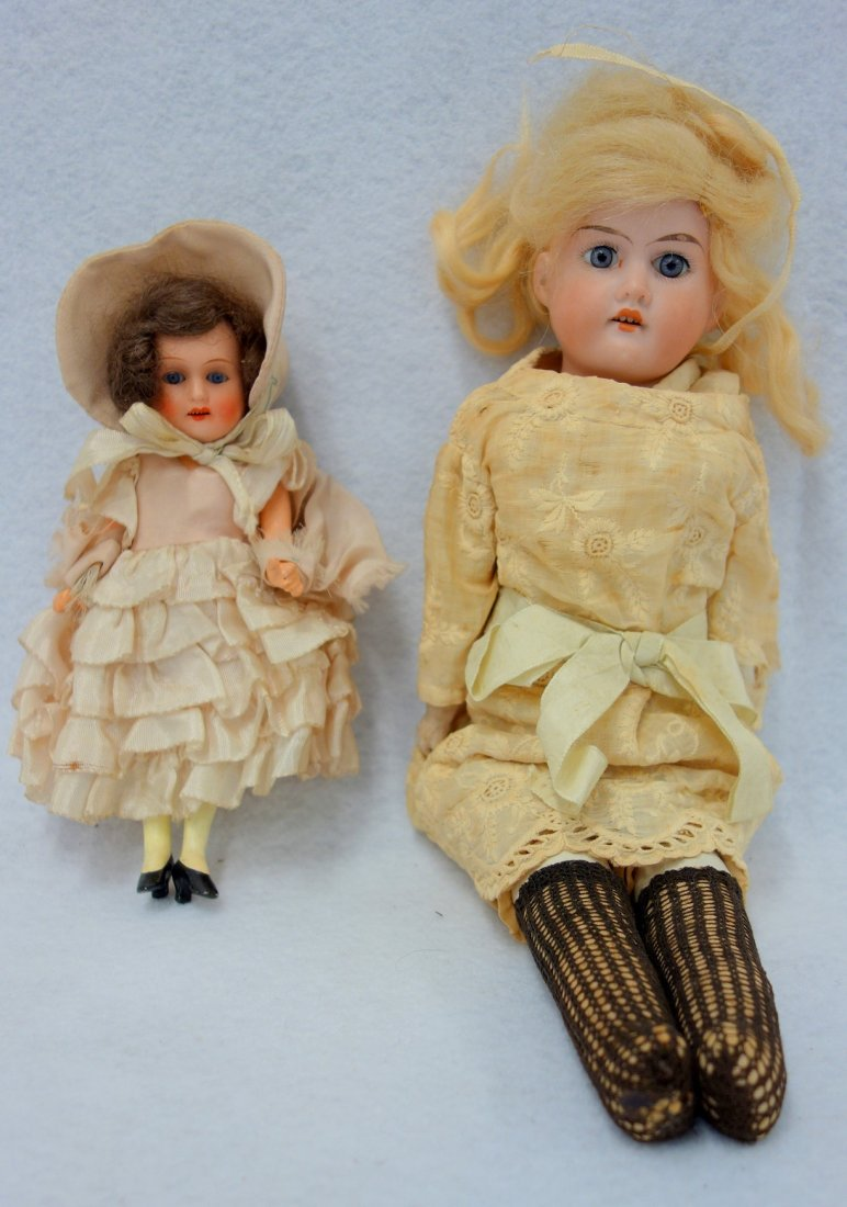 Two dolls including: A bisque head sleepy eyed doll