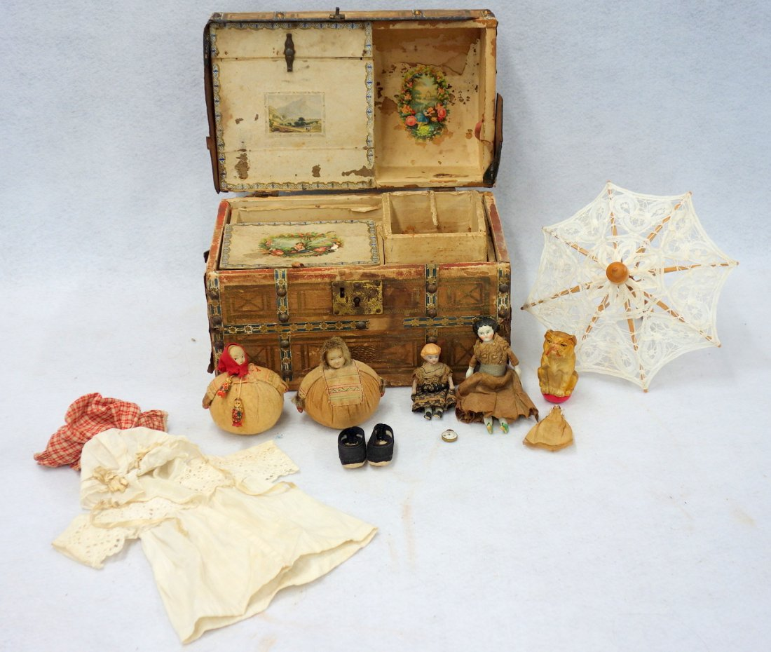 Grouping of doll and toy related collectibles including