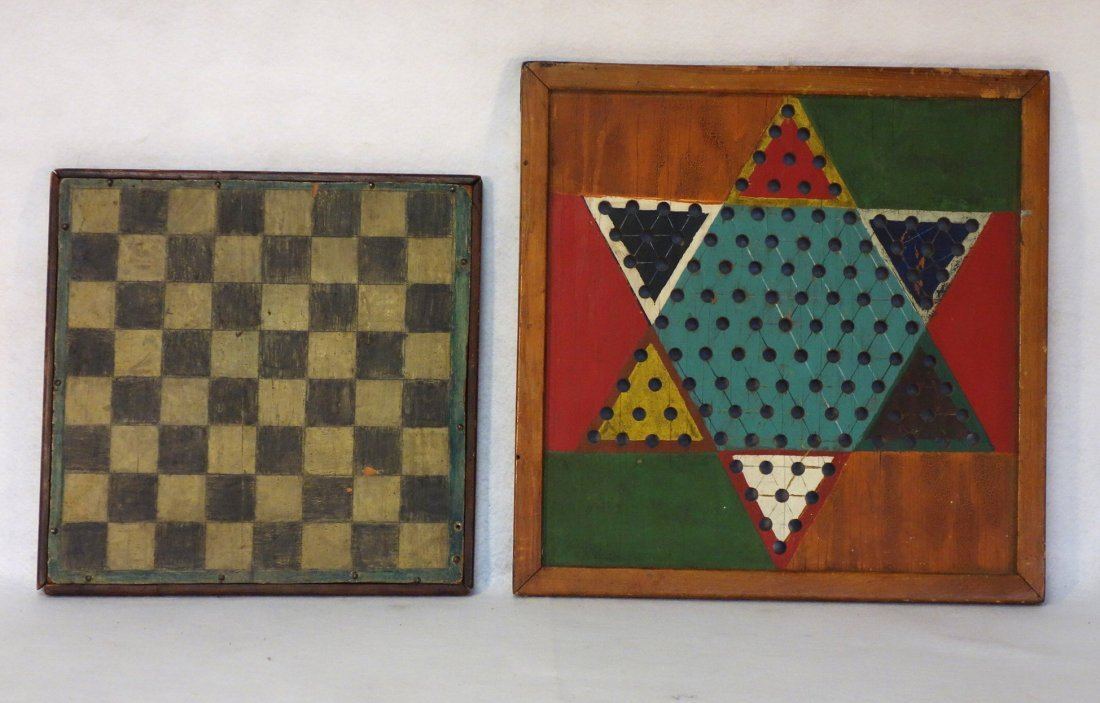 Two game boards including checker board in black and