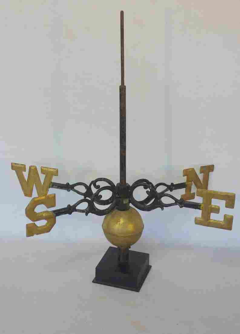 Early weathervane directionals over original gilded