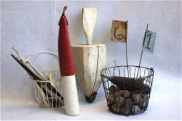 Two hand painted wooden buoys an egg basket filled