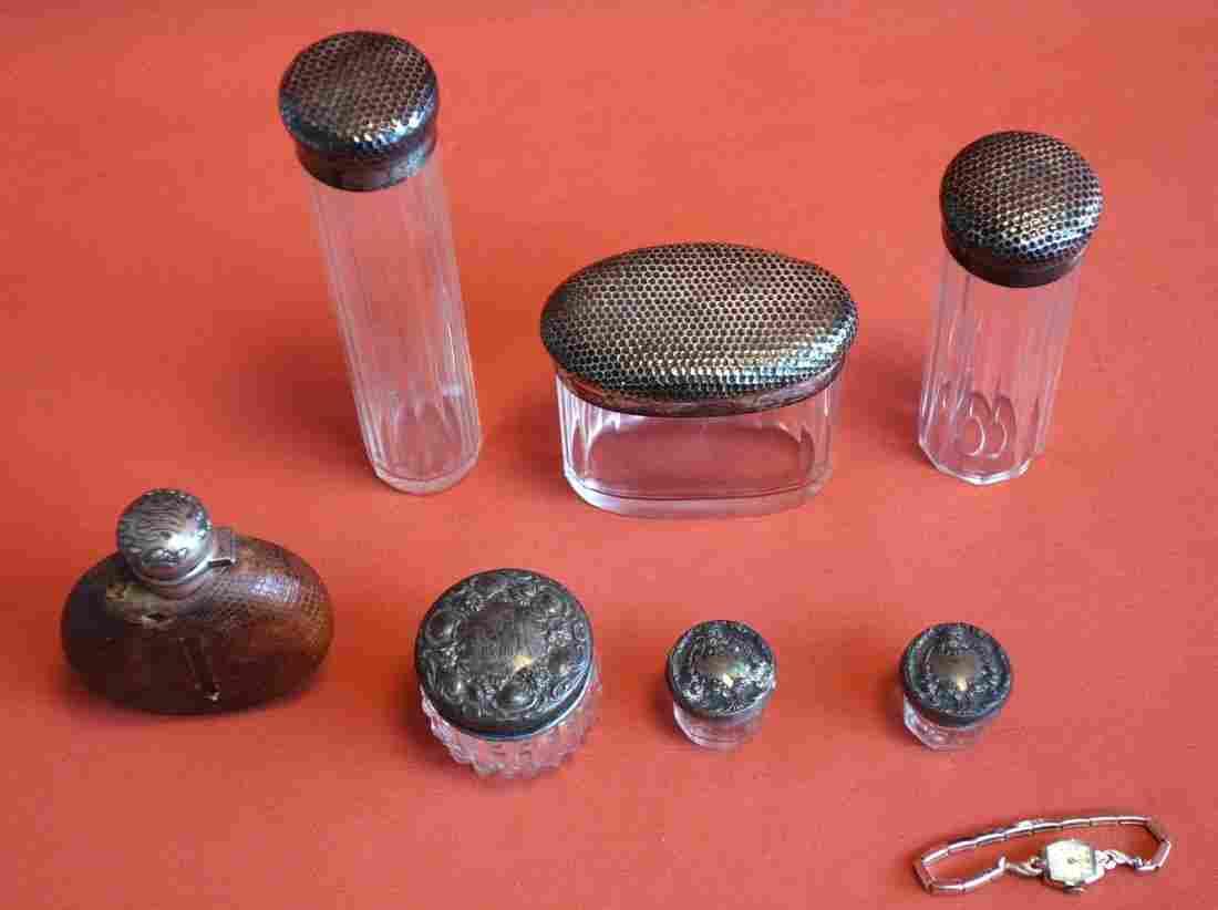 Seven Sterling Silver dresser jars and a 14k gold