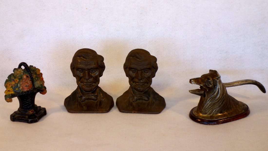 Three cast iron decorative objects including Abe