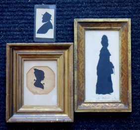 Three Silhouettes Including One Of A Standing Lady