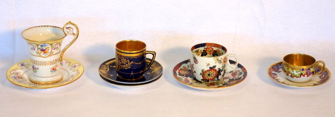 Grouping of 4 demitasse cups and saucers including
