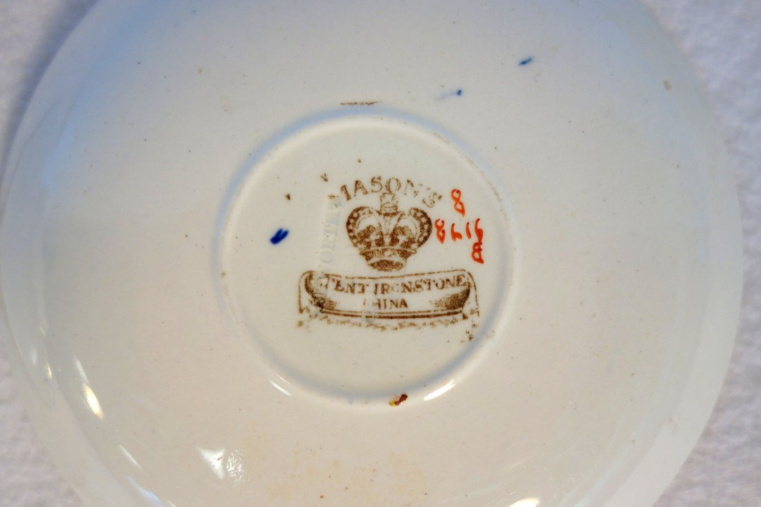 Grouping of 4 demitasse cups and saucers including - 4