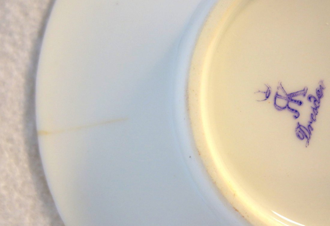Grouping of 4 demitasse cups and saucers including - 8