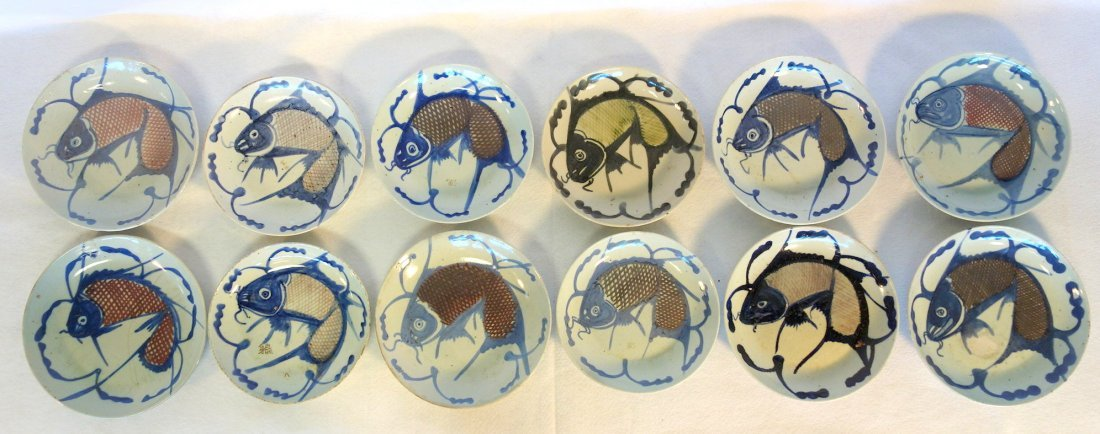 Grouping of 12 early Chinese export fish plates - all