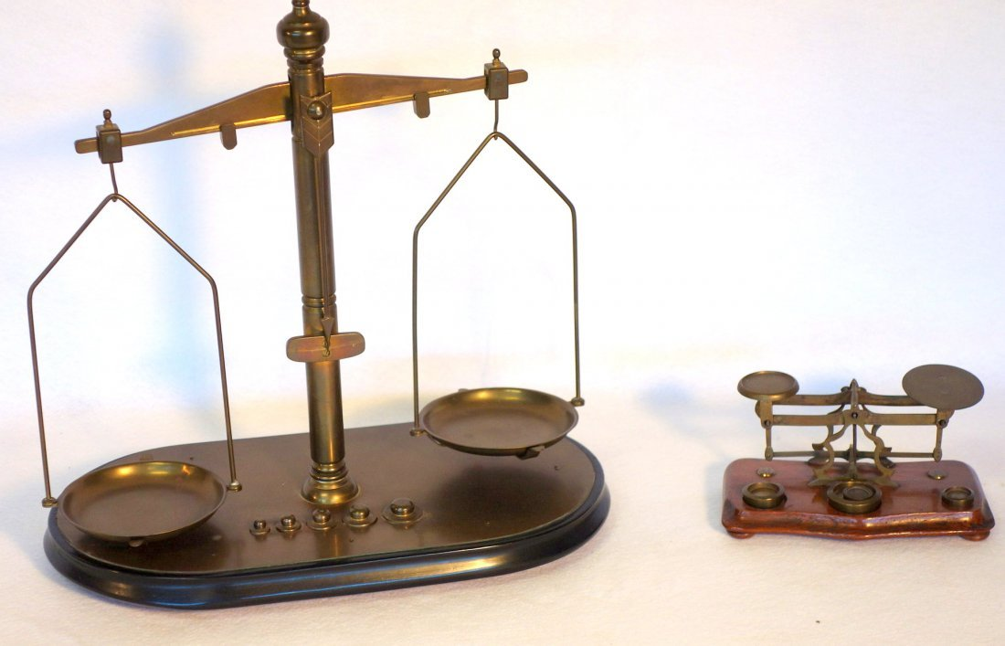 Two balance scales including small brass postage stamp