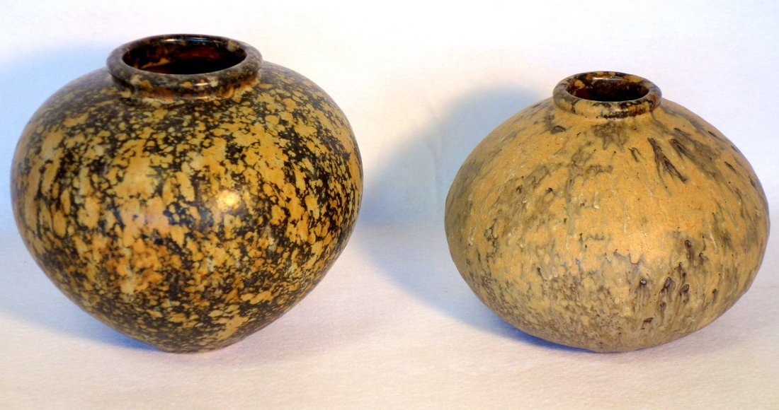 Two art pottery ovoid vases, one with a granite-like
