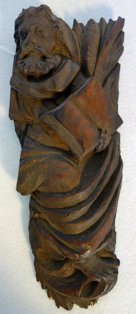 Early carved wood fragment depicting Moses holding the