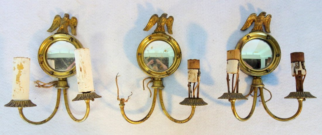 Three brass matching wall sconces with convex mirrors,