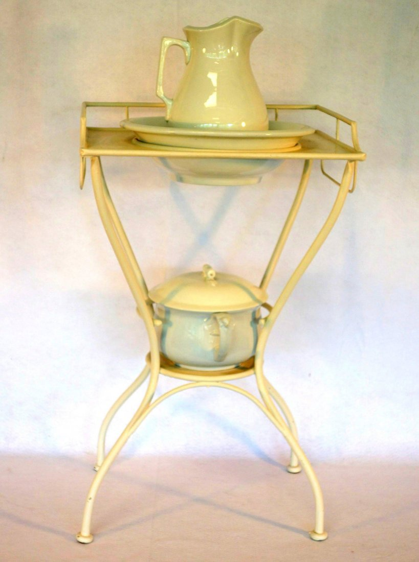 Iron washstand with ironstone bowl, pitcher and non